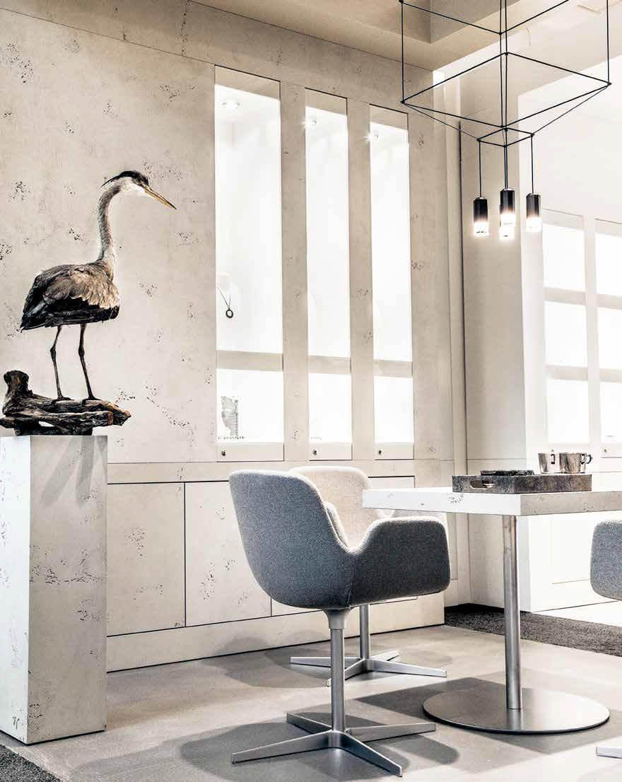 eva Trauringwelten Inneneinrichtung Designbereich - Betondesign in einem hellen grau gehalten.